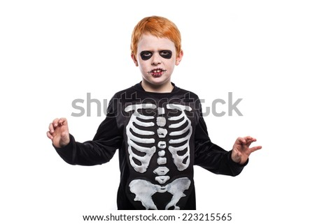 Adorable red hair boy disguised in halloween. Studio portrait isolated over white background - stock photo