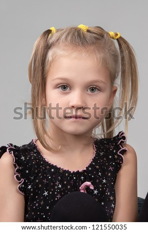 Adorable sad little girl looking at the camera close-up - stock photo