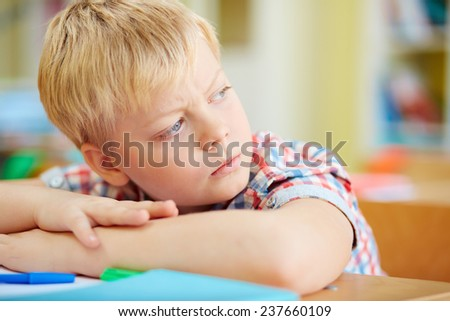 Adorable schoolboy at lesson - stock photo