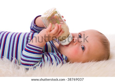 Adorable Seven month Baby eating from bottle - stock photo