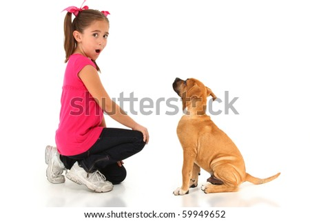 Adorable seven year old american girl with boxer puppy over white. - stock photo