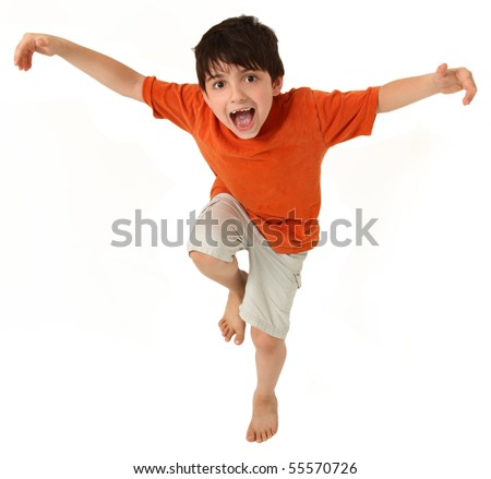 Adorable seven year old boy pretending to do kung fu or being a bird. - stock photo