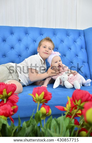 Adorable sister and brother portrait - stock photo