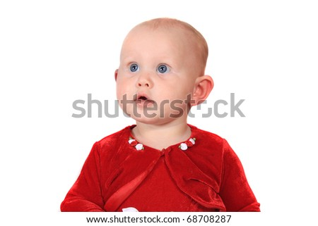 Adorable six month old baby girl with big blue eyes and red velvet jacket on a white background looking  up