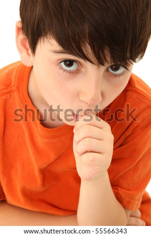 Adorable six year old boy sucking his thumb. - stock photo