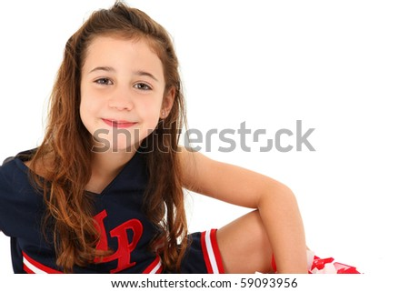 Adorable six year old euro-american girl cheerleader over white. - stock photo