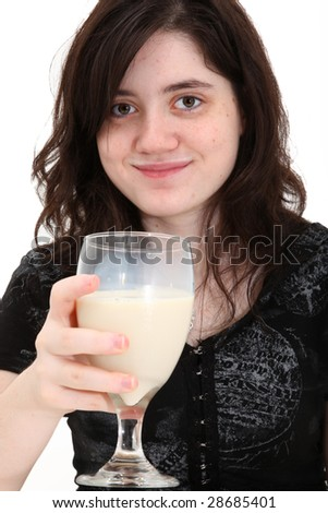 Adorable sixteen year old girl drinking soy-milk (soy milk) with soy-milk mustache. - stock photo
