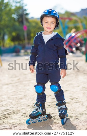 Adorable skater boy posing on the playground - stock photo