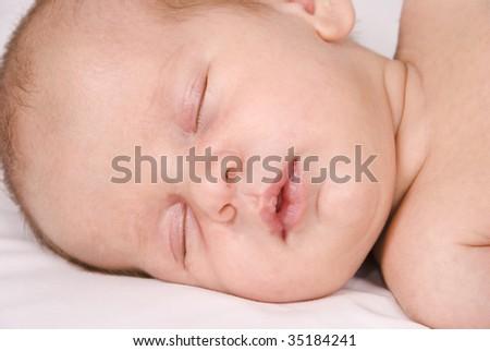 Adorable sleeping baby - stock photo