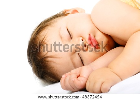Adorable sleeping baby. Isolated on white background.