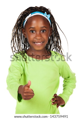 Adorable small african child with braids wearing a bright green shirt. The girl is showing a thumbs up to the camera.