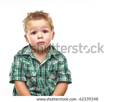 Adorable small boy pleading at the viewer. - stock photo