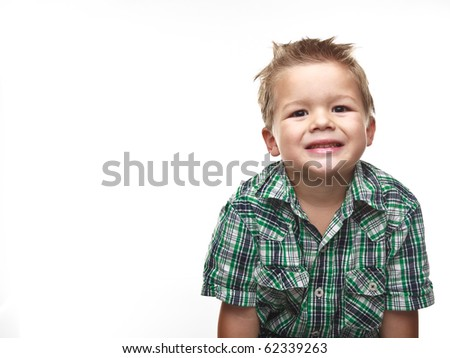 Adorable small boy smiling and wearing plaid.