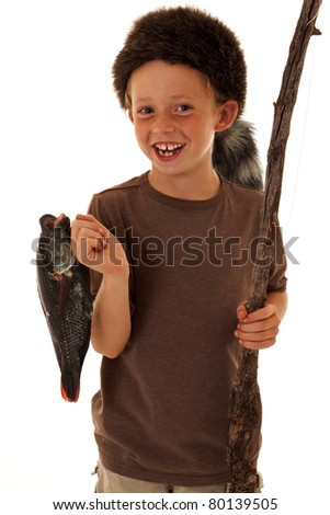 adorable smiling boy with fresh caught fish - stock photo