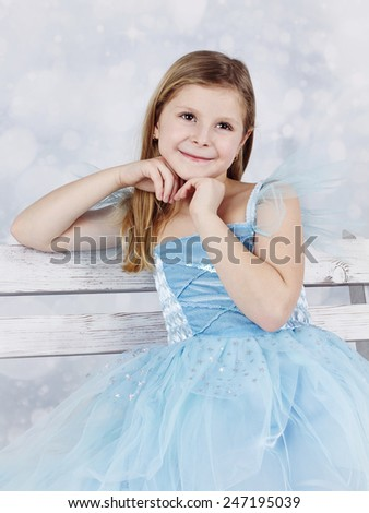 Adorable smiling girl with angel face - stock photo