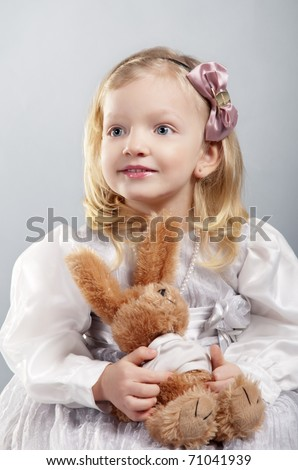 adorable smiling girl 4 years old holds teddy bear