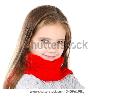 Adorable smiling little girl in red scarf isolated on white background - stock photo