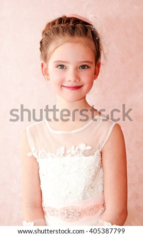 Adorable smiling little girl in white princess dress isolated - stock photo