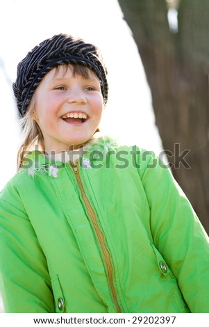 Adorable smiling little girl outdoors shot - stock photo