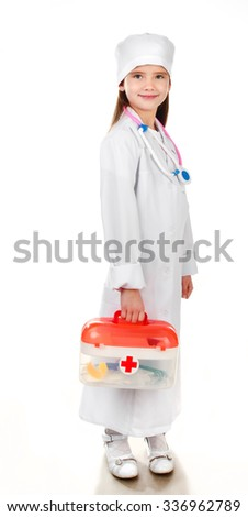 Adorable smiling little girl playing at the doctor isolatedl on a white