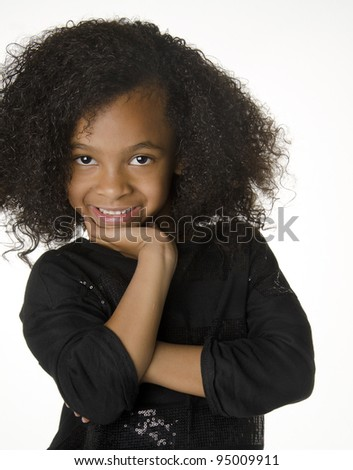 Adorable smiling little girl with gorgeous curly hair - stock photo