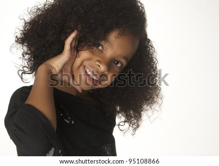 Adorable smiling playful little girl isolated against white background - stock photo