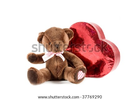 adorable teddy bear siting next to the heart - stock photo