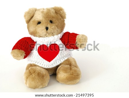 adorable teddy bear wearing red and white sweater with heart, copy space - stock photo