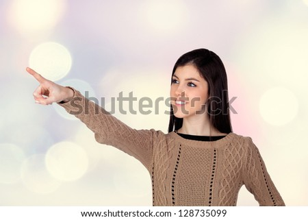 Adorable teenager girl indicating something isolated on a bright background - stock photo