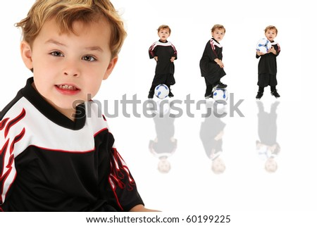 Adorable three year old American boy in soccer football uniform over white background.