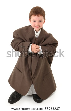 Adorable three year old boy in over sized suit over white. - stock photo