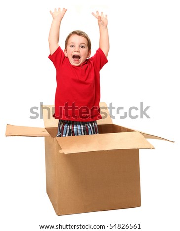 Adorable three year old boy jumping out of box. - stock photo