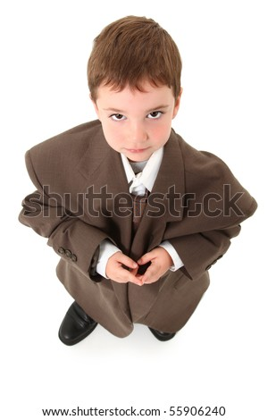 Adorable three year old caucasian boy in over sized suit. - stock photo