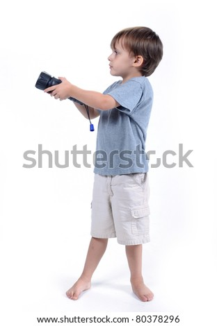 Adorable 3 to 4 year old boy standing with flashlight isolated on white