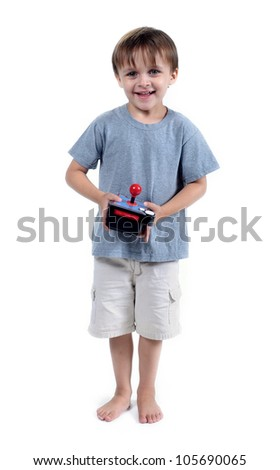 Adorable 3 to 4 year old boy standing with game unit (joy stick) isolated on white