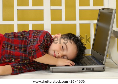 Adorable toddler boy asleep on his laptop. - stock photo