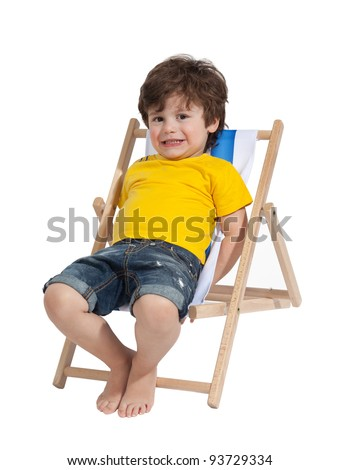 Adorable Toddler boy sitting on deck chair, isolated on white