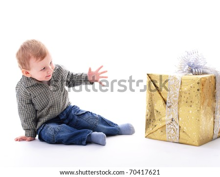 Adorable toddler boy with big gift isolated on white