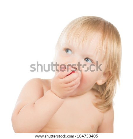 Adorable toddler girl eat strawberry sitting on white background - stock photo