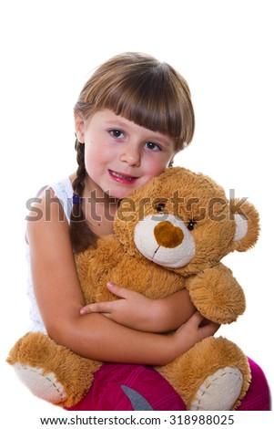 adorable toddler girl hugging a teddy bear - stock photo