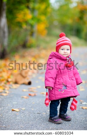 Adorable toddler girl outdoors on beautiful autumn day - stock photo