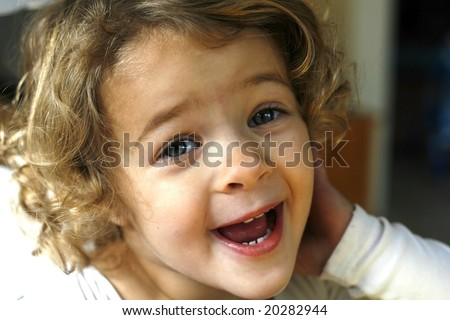 adorable toddler girl with curly hair, silly face - stock photo