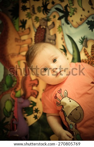 Adorable toddler girl with looking directly at the camera.  - stock photo