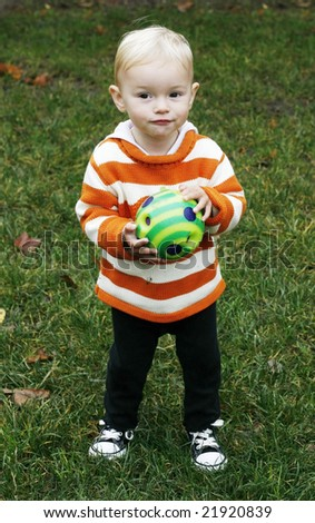 adorable toddler holding ball - stock photo