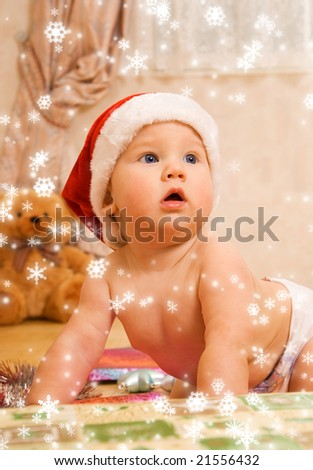 Adorable toddler in Christmas hat