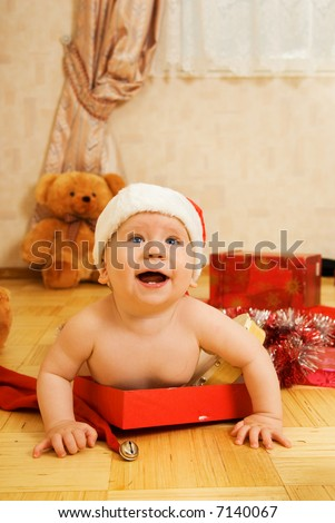 Adorable toddler in Christmas hat - stock photo