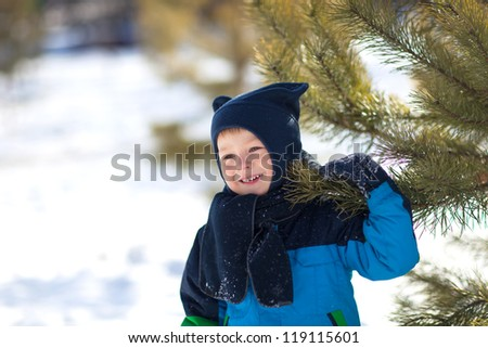 Adorable toddler outside on a winter day - stock photo