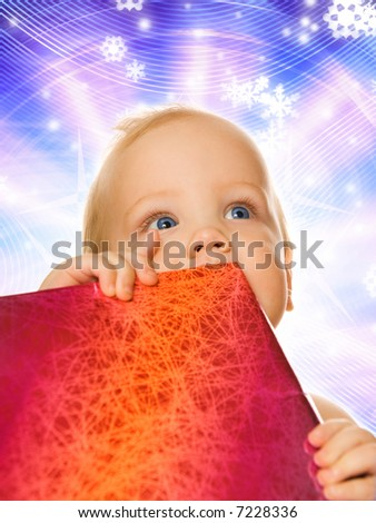 Adorable toddler with a gift box on abstract winter background - stock photo