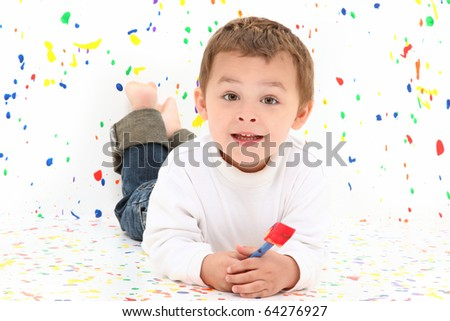 Adorable two year old toddler boy over paint splatter background in casual. - stock photo