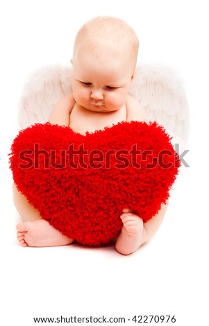 Adorable valentine baby angel looking at heart - stock photo